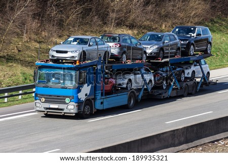 trucks on the highway. road transport for freight. - stock photo