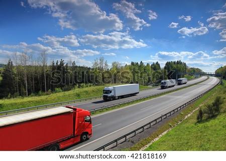 Trucks on the road - stock photo
