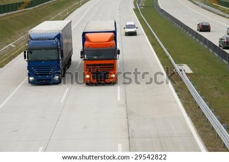 Trucks running on the highway - stock photo
