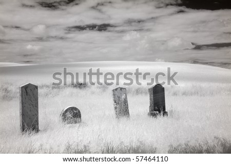 True infrared photograph of four gravestone markers in a cemetery in the Palouse region, Washington state, U.S.A. - stock photo