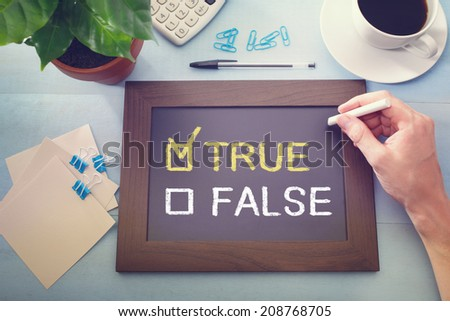 True or False check boxes with True checked, sketched on a little black chalkboard - stock photo