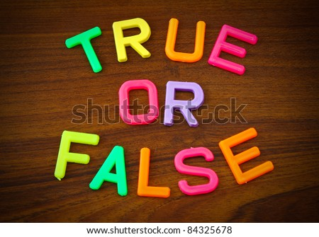 True or false in colorful toy letters on wood background