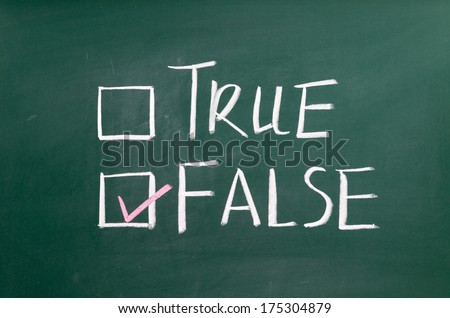 True or false written on a blackboard with white chalk. - stock photo