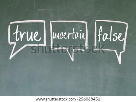 true uncertain and false debate sign on blackboard - stock photo