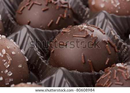 Truffle candy coated chocolate with decorative powdered for the occasion. - stock photo