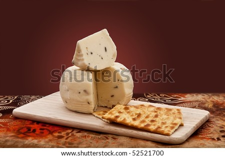 Truffle cheese and crackers on a cutting board - stock photo