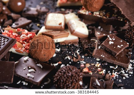truffles, broken chocolate bar and cacao - stock photo