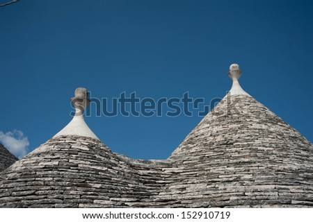 Trulli house in Italy, specific conical roofed houses in Apulia. Unesco World Heritage site famous as a top travel destination in Puglia - stock photo