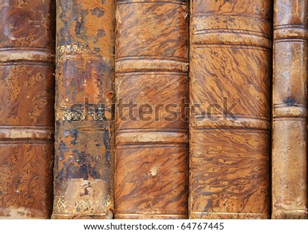 Truly antique leather bound books. - stock photo