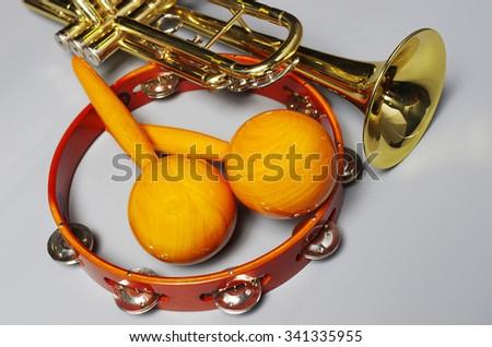 Trumpet, tambourine, maracas - stock photo