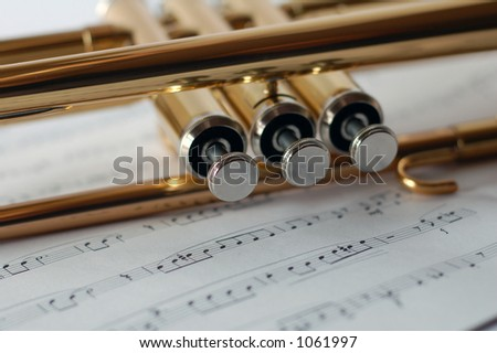 Trumpet Valves close up with music background - stock photo