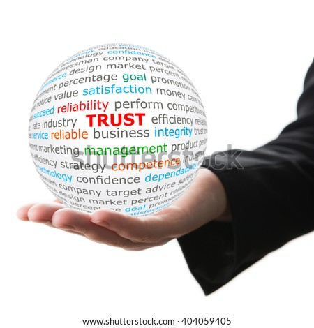 Trust concept. Hand take white ball with trust word in red color. - stock photo