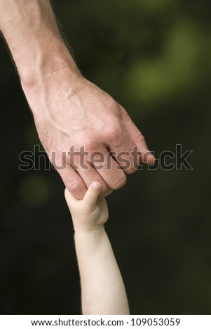 trust family hands of child son and father