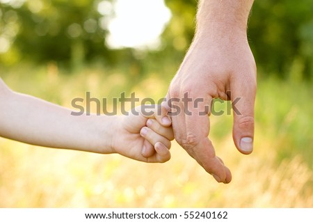 trust family hands of child son and father on wheat field nature outdoor - stock photo