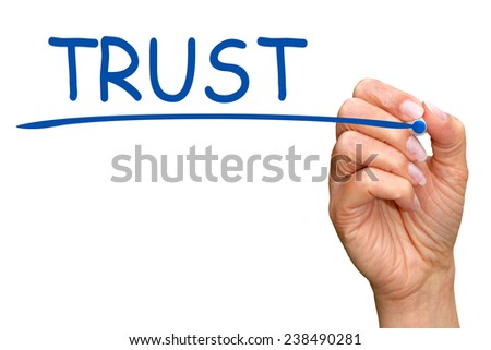 Trust - female hand with blue pen writing on white background - stock photo