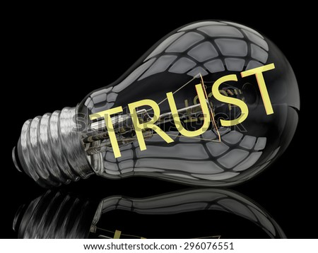 Trust - lightbulb on black background with text in it. 3d render illustration. - stock photo