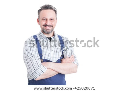 Trustworthy cheerful mechanic holding wrench and posing with arms crossed as success and confidence concept with copyspace isolated on white background - stock photo