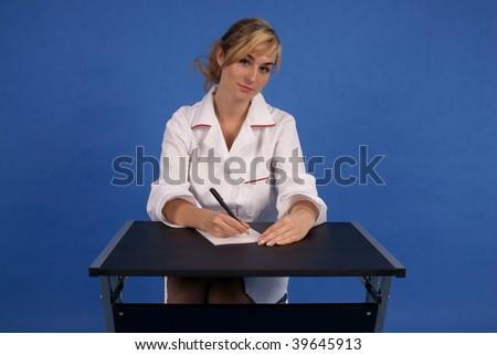 Trustworthy doctor writing prescription - stock photo