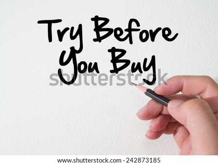 try before you buy text concept on wall - stock photo