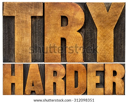 try harder motivational advice -isolated text in vintage letterpress wood type - stock photo