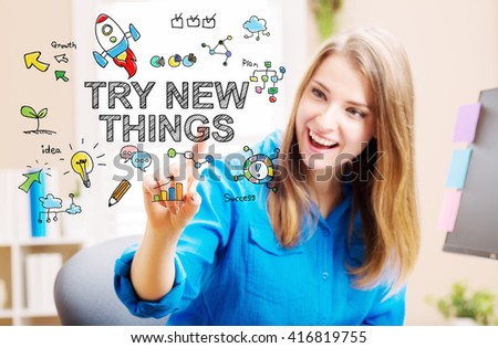 Try New Things concept with young woman in her home office - stock photo