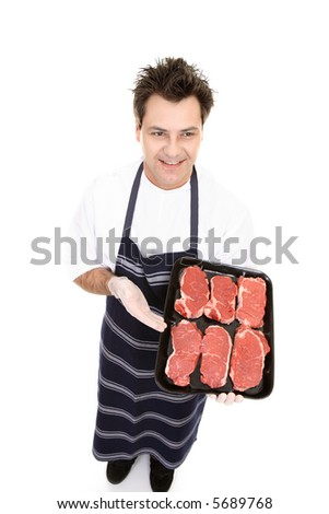 Try out tender beef cuts - butcher displaying some prime lean beef - stock photo