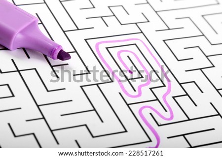 trying to find way out of maze - stock photo