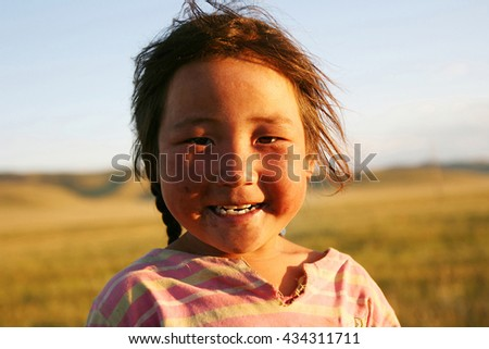 TSALGAR, MONGOLIA - AUGUST 06, 2008: Smiling mongolian girl. Approximately 30% of the Mongolia population is nomadic or semi-nomadic.