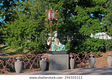 TSARSKOYE SELO, SAINT-PETERSBURG, RUSSIA - JUNE 29, 2015: The Alexander Park. The Large Chinese Bridge with figure of a Chinawoman. Located near Saint-Petersburg  - stock photo