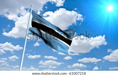 Tsawana Flag in front of vivid, sunny, cloudy sky
