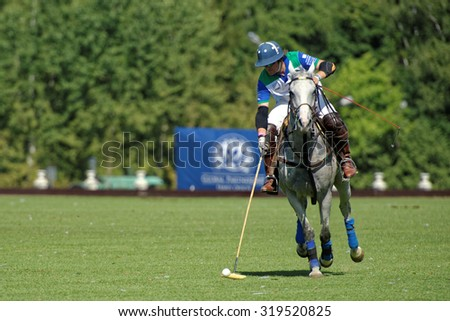 TSELEEVO, MOSCOW REGION, RUSSIA - JULY 26, 2014: Esteban Panelo of Moscow Polo club in action in the match against the team of British Schools during the British Polo Day. Moscow Polo Club won 7-6 - stock photo