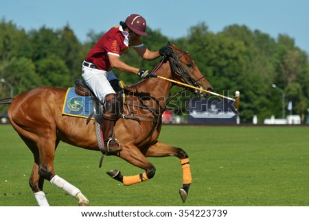 TSELEEVO, MOSCOW REGION, RUSSIA - JULY 26, 2014: Francisco Ramos of Tseleevo Polo club in action during the match against the Oxbridge polo team during the British Polo Day. Oxbridge won 5-4 - stock photo