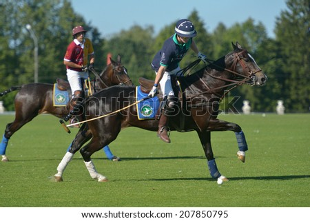 TSELEEVO, MOSCOW REGION, RUSSIA - JULY 26, 2014: Match Tseleevo Polo Club - Oxbridge Polo Team during the British Polo Day. Oxbridge won 5-4