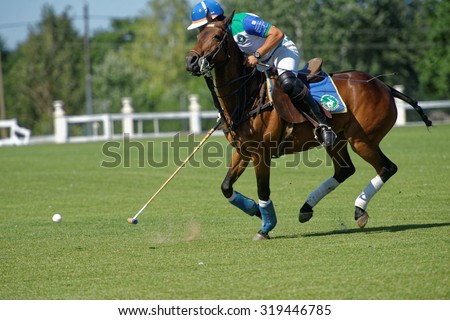 TSELEEVO, MOSCOW REGION, RUSSIA - JULY 26, 2014: Misha Rodzianko of Moscow Polo Club in action in the match against British Schools during the British Polo Day. Moscow Polo Club won 7-6 - stock photo