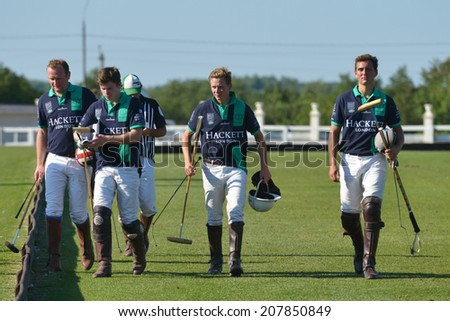 TSELEEVO, MOSCOW REGION, RUSSIA - JULY 26, 2014: Oxbridge Polo Team after the match against the Tseleevo Polo Club during the British Polo Day. Oxbridge won 5-4 - stock photo