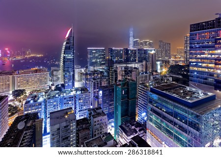 Tsim Sha Tsui at night, hong kong downtown area - stock photo