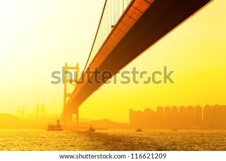 tsing ma bridge at sunset - stock photo