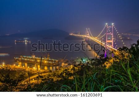 Tsing Ma Bridge at sunset in Hong Kong - stock photo