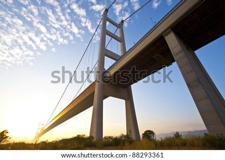 Tsing Ma Bridge in Hong Kong at sunset time - stock photo