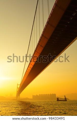 tsing ma bridge in sunset - stock photo