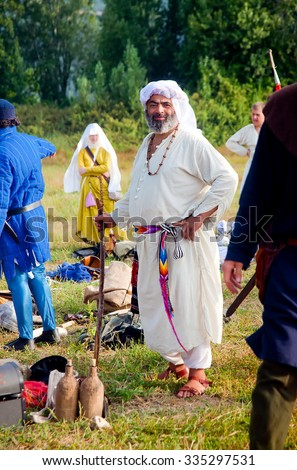 TSIPORI, ISRAEL - JULY 7, 2014: Medieval Dervish in knights camp at history reenactment event of Battle of Hattin - last battle of Crusaders' Kingdom of Jerusalem marking its fall in 1187.