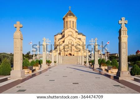 Tsminda Sameba Church (The Holy Trinity Cathedral of Tbilisi) at evening, located in Tbilisi, capital of Georgia - stock photo
