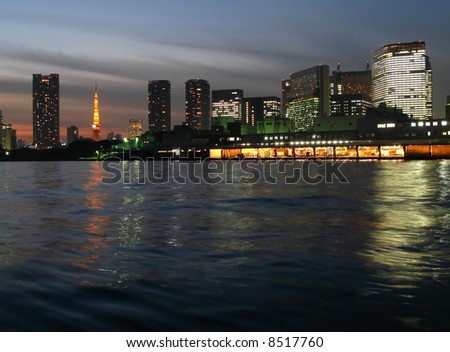Tsukiji Fish Market and Tokyo skyline, night, Japan