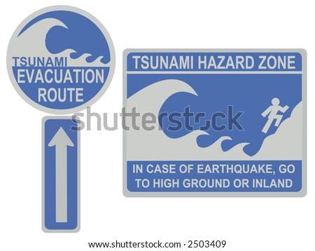 Tsunami evacuation route and hazard zone signs - stock photo