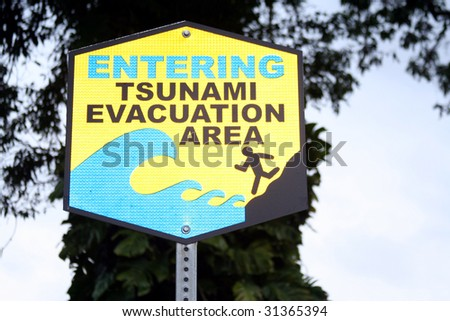 Tsunami evacuation warning sign. - stock photo