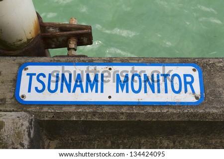 Tsunami Monitor Sign - stock photo
