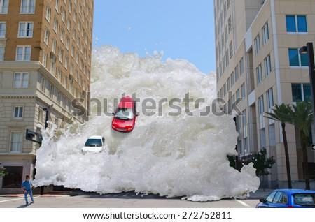 Tsunami tidal wave washing through a city street pushing cars out of the way and speeding towards a pedestrian - stock photo