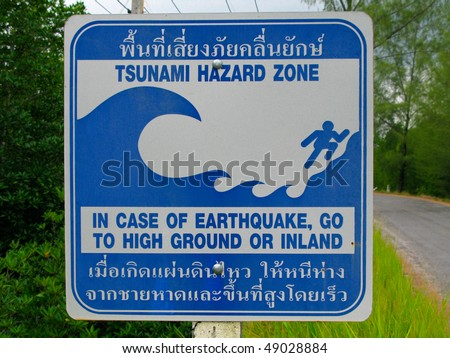 Tsunami zone Sign in Thai and English - stock photo