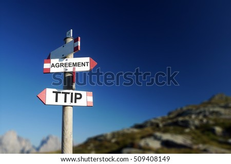 TTIP agreement written on signpost in mountains. Negotiations concept.