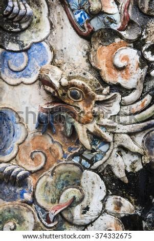 Tu Duc Mausoleum detail of the Mosaic Spirit Screen decorated with  glazed ceramics, porcelain mosaic and fresco painting, Vietnam - stock photo